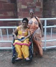 Smitha Sadasivan, who has Multiple Sclerosis on a wheelchair accompanied by her mother