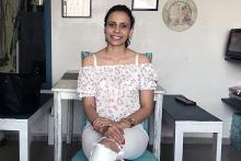 Pic shows Aditi sitting confidently with her vitiligo patches