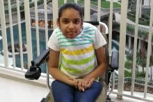 A young girl with Spinal Muscular Atrophy and Scoliosis on a wheelchair