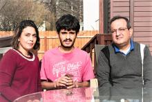 Image: Left to Right. On the Left is Harshita the mom in a red dress, in the center is Sahil in a pink T Shirt and the on the right is the father in a green shirt