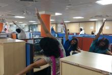 Image: Employees working out next to their desks