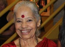 The author Dr Kalyani, a heart patient in a red sari and smiling
