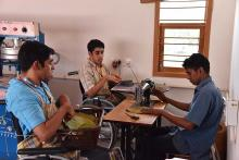 3 young men including Sriram and Sunder at work in the factory