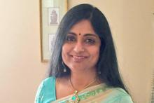 Image: Smiling woman wearing a sari looking at the camera tells her fibromyalgia story