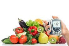 Glucometer and a tray of fruits