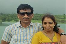 Vijay Bhende in a white shirt on the left with his wife in a yellow kurta on the right