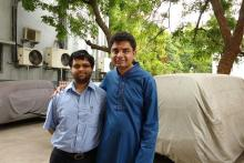 Image: Bharat in a blue kurta and Viraj in a light shirt together against an outdoor setting. Both are diagnosed with Asperger's syndrome and work in development in SAP Labs