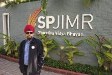Gagandeep standing outside SPJIMR