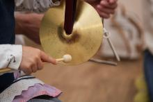 A girl playing cymbals
