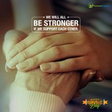 Image desription: A pair of hands on an older persons hands. Text on the image - We Will All Be Stronger If We Support Each Other