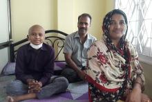 A child with cancer with his parents