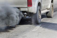 Image: A white car spewing exhaust fumes causing pollution which affects respiratory health