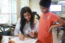 Image: A woman and a young boy looking at the special menu for dyslexia awareness