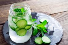 Image of a jar of water with cucumber and mint. Risk of Dehydration in Winter