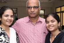 Mr. Aleem Baig in the centre in a pink shirt flanked by his 2 daughters who have thalassemia major