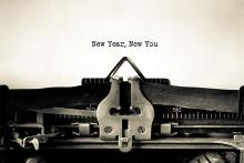 Sepia tone image of typewriter with the typed words - New Year, New You